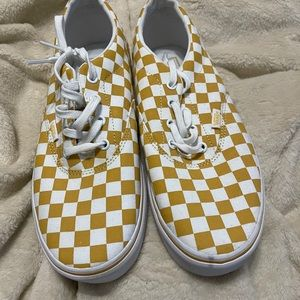 Yellow and white checkerboard Vans